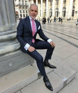 How to Wear Black Leather Monks: This is solid proof that a navy vertical striped suit and a white dress shirt look awesome when matched together in a sophisticated ensemble for a modern dandy. When not sure as to the footwear, stick to black leather monks.
