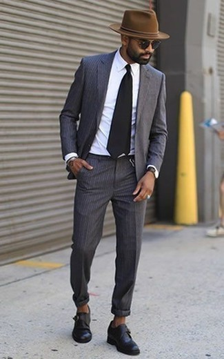 How to Wear Black Leather Monks: Reach for a charcoal vertical striped suit and a white dress shirt for a neat classy getup. As for shoes, add black leather monks.