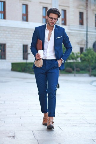 How to wear: brown leather zip pouch, tan leather monks, white long sleeve shirt, navy suit
