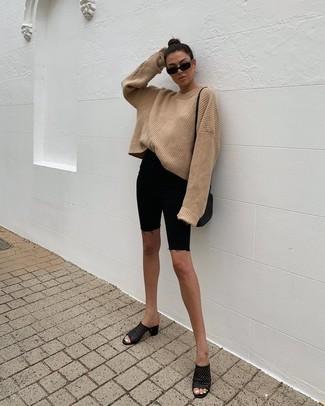 How to wear: black leather crossbody bag, black leather mules, black denim bike shorts, tan knit oversized sweater