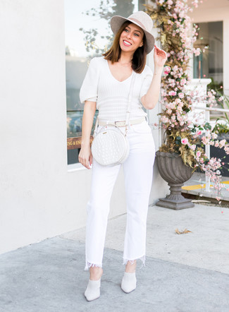 How to Wear a White Short Sleeve Sweater For Women: Try teaming a white short sleeve sweater with white flare jeans to don a seriously stylish getup. Ramp up the wow factor of this ensemble by slipping into white leather mules.