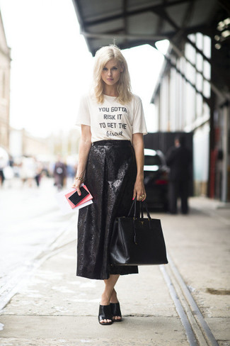 Which Midi Skirt To Wear With a White and Black Crew-neck T-shirt: If you gravitate towards casual style, why not opt for this pairing of a white and black crew-neck t-shirt and a midi skirt? You can get a little creative in the footwear department and add black leather mules to this outfit.