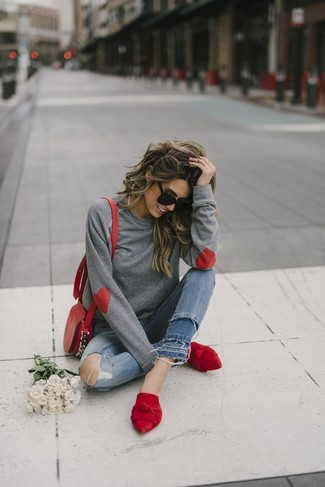 How to Wear a Grey Sweatshirt For Women: Pair a grey sweatshirt with blue ripped skinny jeans for a cool and trendy outfit. Want to go all out on the shoe front? Round off with red suede mules.