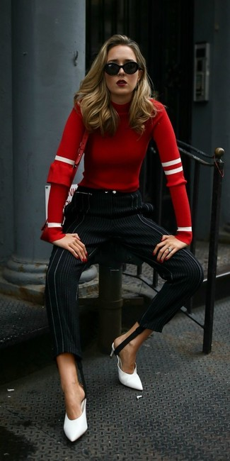 How to Wear a Red Leather Crossbody Bag: A red crew-neck sweater and a red leather crossbody bag are definitely worth being on your list of bona fide casual staples. To bring a little zing to your getup, introduce white leather mules to the mix.