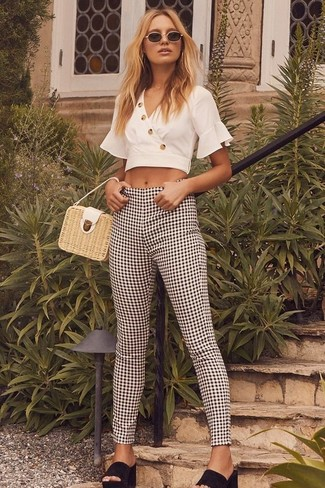 How to wear: beige straw handbag, black suede mules, black and white gingham skinny pants, white cropped top