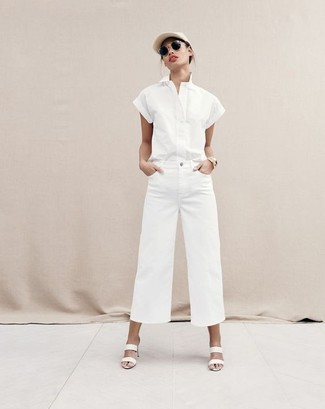 How to wear: beige cap, white leather mules, white denim wide leg pants, white short sleeve button down shirt