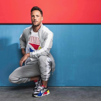 How to wear: multi colored athletic shoes, grey track suit, white print crew-neck t-shirt