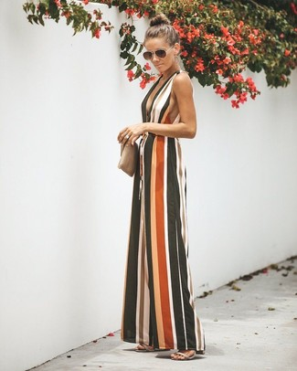 How to wear: multi colored vertical striped jumpsuit, grey leather heeled sandals, beige leather clutch, black sunglasses