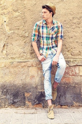 How to wear: multi colored plaid long sleeve shirt, light blue ripped skinny jeans, tan suede desert boots, tan straw hat