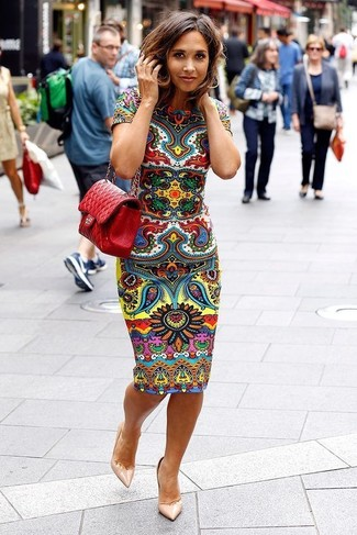 How to wear: multi colored print bodycon dress, beige leather pumps, red quilted leather crossbody bag