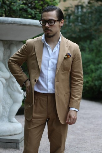 How to wear: multi colored print pocket square, white long sleeve shirt, tan suit