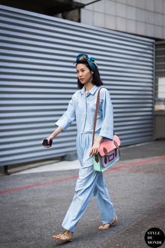 How to wear: blue print scarf, multi colored leather satchel bag, gold leather flat sandals, light blue jumpsuit