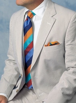 How to wear: multi colored print pocket square, multi colored horizontal striped tie, white dress shirt, beige seersucker suit