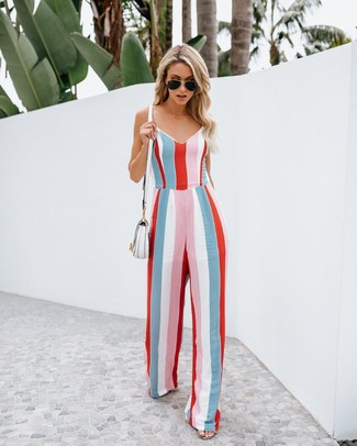How to wear: multi colored vertical striped jumpsuit, white leather crossbody bag, black sunglasses