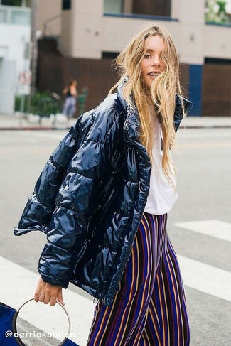 Teen Girl Fashion: What To Wear: A black puffer jacket looks especially cool when matched with multi colored vertical striped wide leg pants in a relaxed look.
