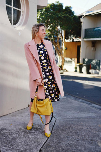 How to Wear a Pink Coat For Women: Pair a pink coat with a black floral skater dress and you'll be ready for wherever this day takes you. Put a more casual spin on your look by slipping into mustard leather ballerina shoes.