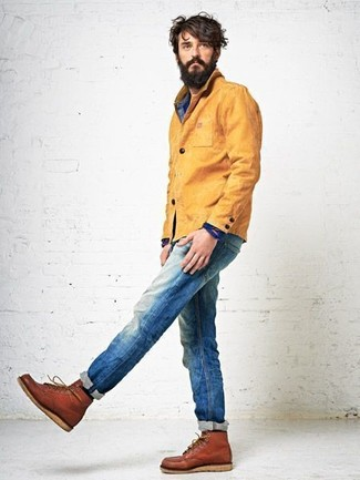 How to wear: mustard barn jacket, blue denim shirt, blue jeans, tobacco leather casual boots