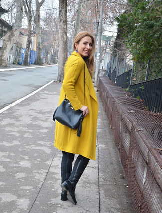 How to wear: mustard coat, black leather over the knee boots, black leather bucket bag, blue earrings