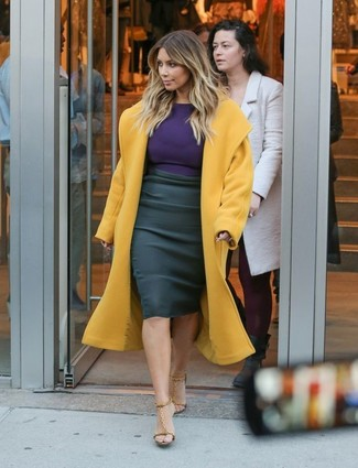 Kim Kardashian wearing Mustard Coat, Violet Long Sleeve T-shirt, Black Pencil Skirt, Tan Leather Heeled Sandals