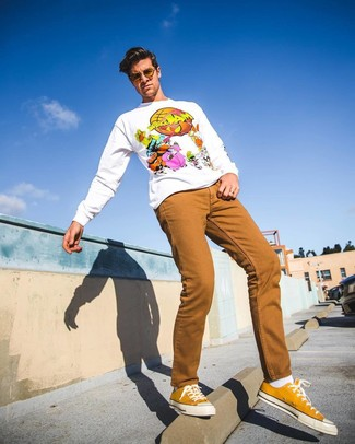 How to wear: white socks, mustard canvas low top sneakers, tobacco jeans, white print sweatshirt