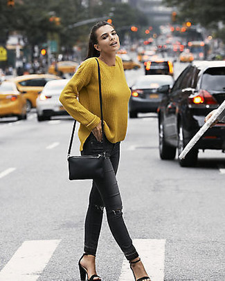 How to wear: mustard oversized sweater, black ripped skinny jeans, black suede heeled sandals, black leather crossbody bag