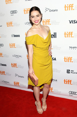 Emilia Clarke wearing Mustard Sheath Dress, Beige Embellished Suede Heeled Sandals, Beige Clutch