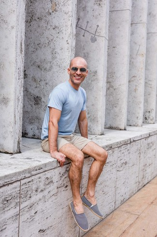 How to wear: charcoal sunglasses, navy and white canvas espadrilles, beige shorts, light blue crew-neck t-shirt