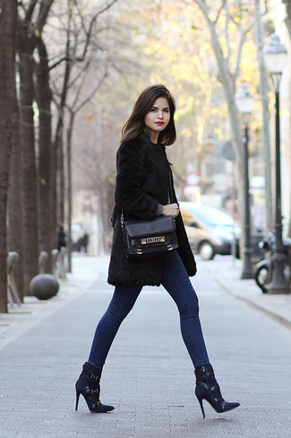 How to wear: black leather satchel bag, navy suede ankle boots, blue skinny jeans, black fur coat