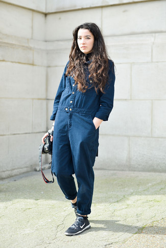 How to wear: navy athletic shoes, navy denim jumpsuit