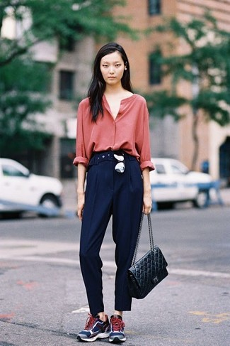 How to wear: black quilted leather satchel bag, navy athletic shoes, navy dress pants, red button down blouse