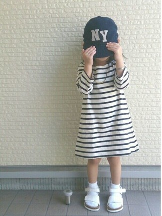 How to wear: white socks, navy baseball cap, white sandals, white and black horizontal striped dress