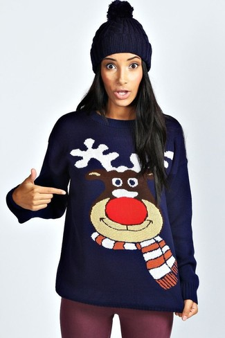 How to Wear a Navy Christmas Crew-neck Sweater For Women: If you're looking for a laid-back and at the same time seriously stylish outfit, try pairing a navy christmas crew-neck sweater with purple leggings.