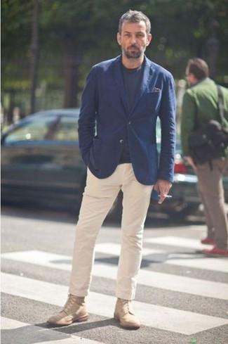 Nick Sullivan wearing Navy Blazer, Black Crew-neck T-shirt, Beige Chinos, Tan Boots