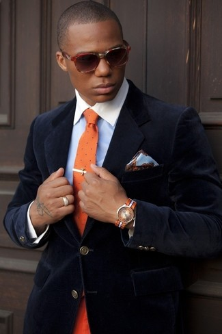 A velvet blazer and a light blue dress shirt are great essentials to incorporate into your current wardrobe. So if it's a summertime afternoon and you want to look sharp without putting too much effort, this look will do the job in seconds time.