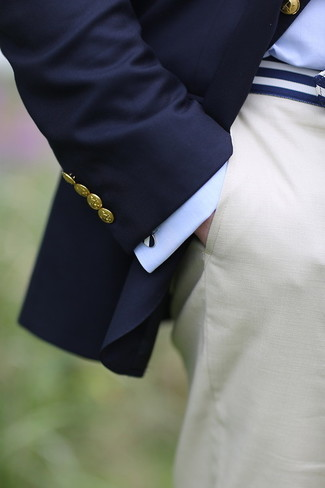 How to wear: navy blazer, light blue dress shirt, white dress pants, white and navy canvas belt