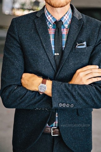 Go for a sophisticated look in a navy blue wool blazer and a multi colored tartan button-down shirt. Seeing as fall is taking over, this look seems a wise option for the time in between seasons.