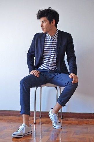How to wear: navy blazer, white and navy horizontal striped long sleeve shirt, navy chinos, white canvas low top sneakers