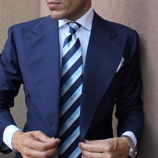 How to wear: navy blazer, white dress shirt, blue vertical striped tie, blue paisley pocket square
