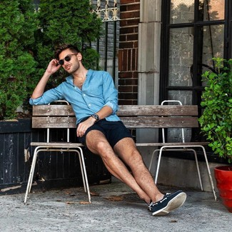 How to wear: navy leather watch, navy canvas boat shoes, navy shorts, blue chambray long sleeve shirt