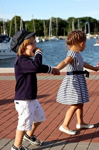 How to Wear Navy Boat Shoes For Boys: This combo of a navy long sleeve t-shirt and white shorts is both a comfortable and stylish choice for your child. Round off this style with navy boat shoes.