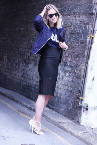 How to wear: navy bomber jacket, navy print crew-neck t-shirt, black leather pencil skirt, white leather heeled sandals