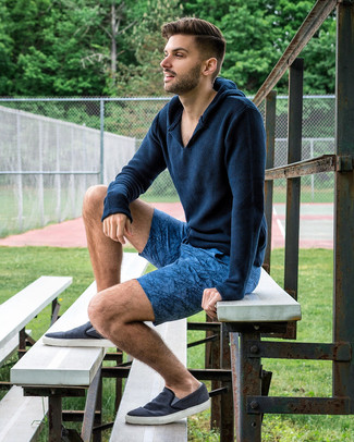 How to wear: navy canvas slip-on sneakers, blue print shorts, navy knit hoodie
