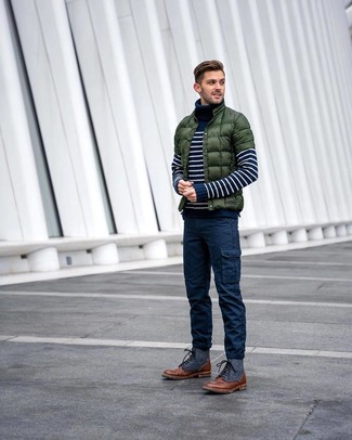 How to wear: brown leather casual boots, navy cargo pants, navy and white horizontal striped turtleneck, dark green puffer jacket