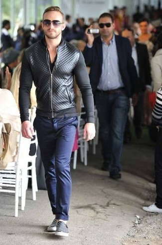 How to wear: black leather slip-on sneakers, navy chinos, black v-neck t-shirt, black quilted leather bomber jacket