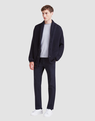 How to wear: white leather low top sneakers, navy chinos, grey crew-neck t-shirt, navy shawl cardigan