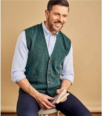 How to Wear Pants For Men: A dark green sweater vest and pants teamed together are a great match.