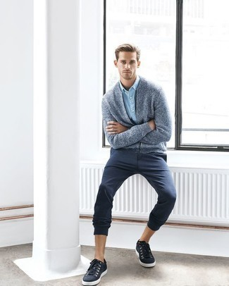 How to Wear Navy Canvas Low Top Sneakers For Men: A light blue knit bomber jacket and navy chinos are absolute menswear staples that will integrate brilliantly within your off-duty collection. Our favorite of a variety of ways to round off this ensemble is a pair of navy canvas low top sneakers.