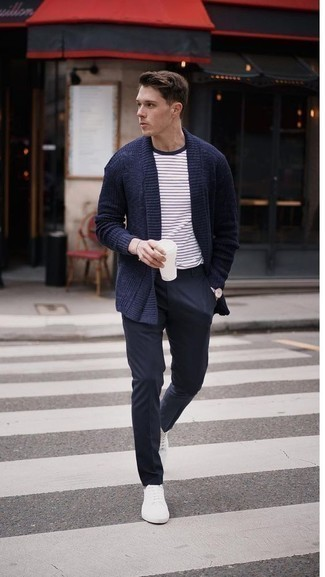 Men's Looks & Outfits: What To Wear In 2020: This combo of a navy shawl cardigan and navy chinos looks elegant, but in a cool kind of way. And if you want to immediately dress down this look with one item, add a pair of white low top sneakers to your ensemble.