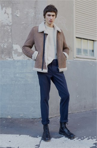 How to wear: black leather casual boots, navy vertical striped chinos, white cable sweater, brown shearling jacket