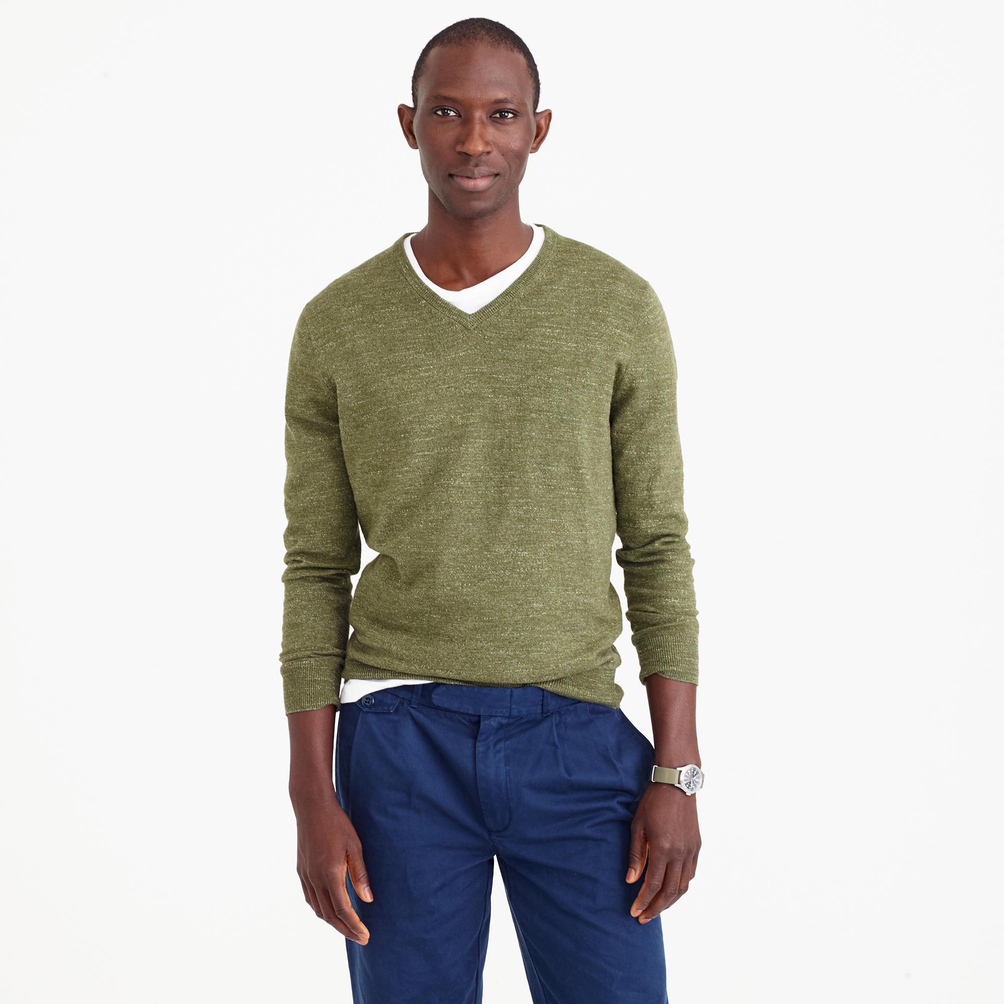 white shirt under v neck sweater